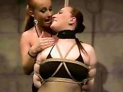Classy mistress punishing busty redhead
