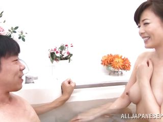 full-grown japanese lady gets in the tub with him