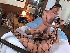 Busty milf in fishnet stockings exchanges oral sex pleasures with her man
