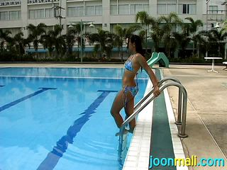 asian cutie in sexy bikini cools off on a clammy day