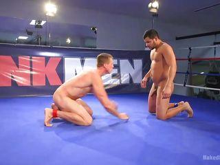 muscular men fighting and sucking