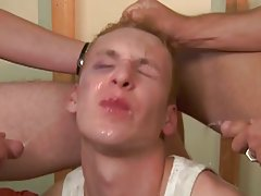 Two guys shower a twink with piss