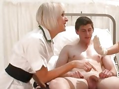 Two blonde nurses check a small shaft
